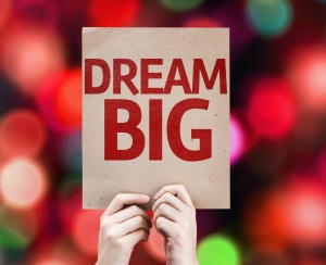 Dream Big card with colorful background with defocused lights