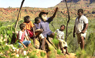 Aboriginal traditional owner and elder of Nyikina country, John Watson, shows his grandchildren his special lands in Western Australia's Kimberley area.