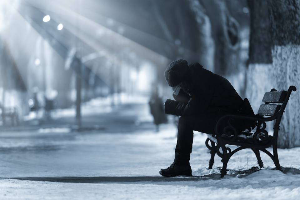 Depressed woman on a bench
