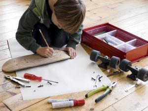 Boy designing his skateboard