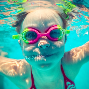 Underwater portrait of happy child. Summer vacation