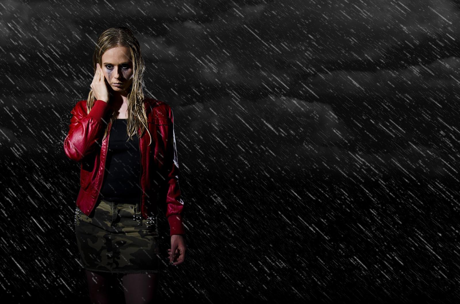 woman walking in the rain horizontal